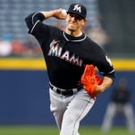Miami Marlins starting pitcher Jose Fernandez throws a pitch against the Atlanta Braves in the first inning at Turner Field.