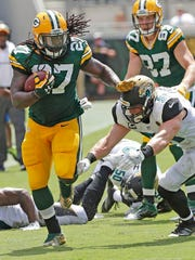 Green Bay Packers running back Eddie Lacy (27) chugs down the sidelines as middle linebacker Paul Posluszny (51) tries to make the tackle against the Jacksonville Jaguars at Everbank Field.