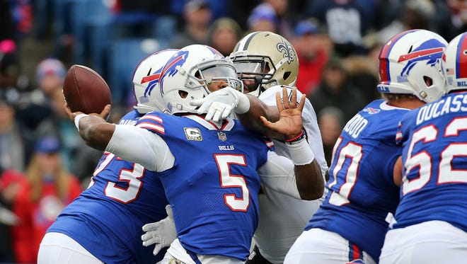 Bills quarterback Tyrod Taylor is hit by Saints Alex Okafor as he throws downfield.  Taylor was pressured the entire game and only threw for 56-yards in a 47-10 loss.
