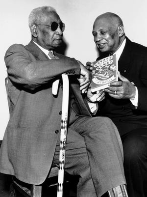"W.C. Handy, right, came back to Memphis on Oct. 29, 1953, and presented a copy of his book ""Father of the Blues"" to Matthew Thornton, the longtime ""Mayor of Beale Street."" Handy was in town to help inaugurate the nation's first black amateur television program to be broadcast the next night on WMCT from the stage of Handy Theatre."
