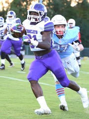 Haywood's Decourtney Reed runs the ball against USJ