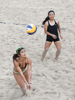 In this file photo from July 2017, Ivee Ilao, left, keeps her eye on the ball during a summer tournament at The Beach Bar and Grill.