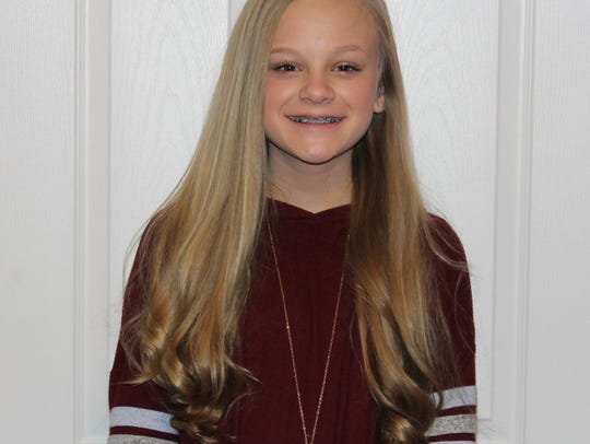 Kerrigan Edwards is a teen panelist and eighth-grader