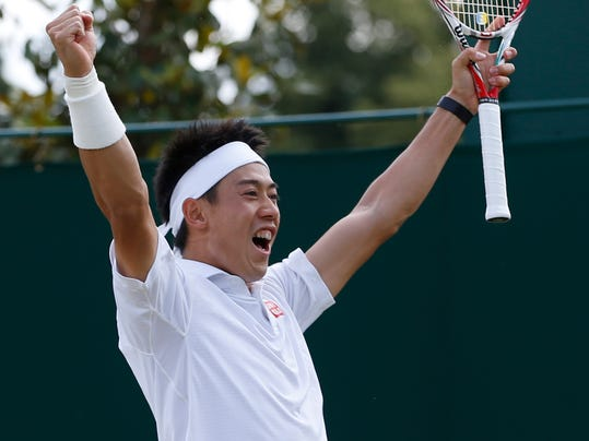 Kei Nishikori of Japan celebrates defeating Simone Bolelli of Italy in their men's singles match at the All England Lawn Tennis Championships in Wimbledon, London, Monday, June 30, 2014. (AP Photo/Alastair Grant)