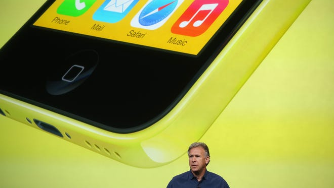Apple Senior Vice President of Worldwide Marketing at Phil Schiller speaks about the new iPhone 5C during an Apple product announcement at the Apple campus.