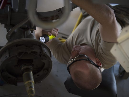 Senior Airman Joe, a 49th Maintenance Squadron munitions crew chief, inspects the bottom of an ammunitions trailer during a 720-day inspection at Holloman. During the inspection, crew chiefs disassembled and checked every aspect of the trailer for any cracks, breaks, missing parts and damages. (Last names are withheld due to operational requirements).