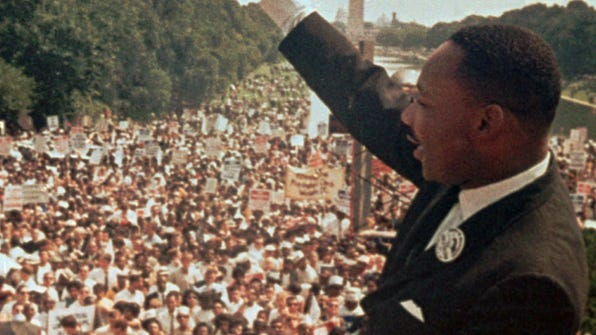 Dr. Martin Luther King Jr. acknowledges the crowd at