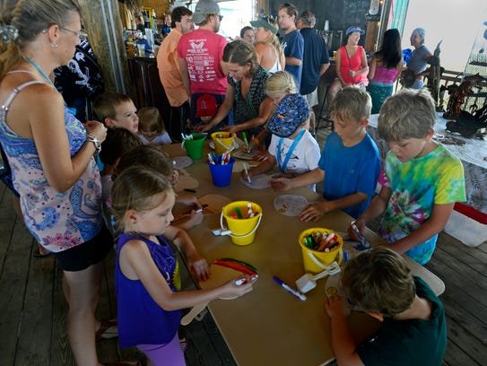 Kids color during last year's Sea Turtle Baby Shower