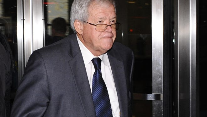 """FILE - In this Oct. 28, 2015 file photo, former U.S. House Speaker Dennis Hastert leaves the federal courthouse in Chicago. Federal prosecutors say when they questioned Hastert about his large cash withdrawals the former House speaker told them he was being extorted by someone making a false claim of sex abuse. In a court filing Friday, April 8, 2016, prosecutors say Hastert agreed to let investigators record phone conversations he had with the man who later became known as """"Individual A."""" Agents later questioned Individual A, who told them about abuse that occurred when he was 14. (AP Photo/Matt Marton File)"""