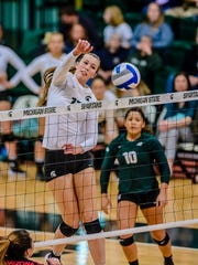 MSU's Alyssa Garvelink skies over the net hit a kill