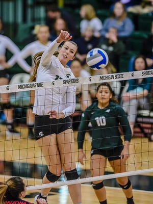 MSU's Alyssa Garvelink skies over the net for a kill against Arizona in the second set of their NCAA tournament second-round match Saturday at Jenison Field House in East Lansing.