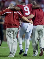 Alabama defensive lineman Da'Shawn Hand (9) is helped from the field after being injured against Ole Miss in second half action at Bryant-Denny Stadium in Tuscaloosa, Ala. on Saturday September 30, 2017. (Mickey Welsh / Montgomery Advertiser)