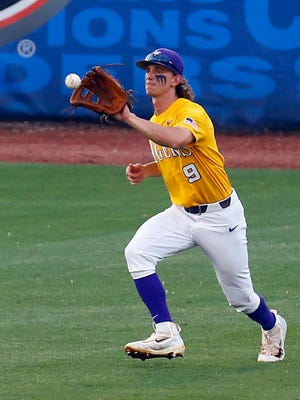 LSU outfielder Zach Watson catches a fly ball during the third inning of an SEC Tournament game.