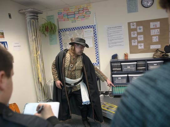 """Theater Ensemble Arts actor Chuck Holmes plays a witness to a crime portrayed in a scene from the play """"Romeo and Juliet"""" Wednesday at Piedra Vista High School in Farmington."""