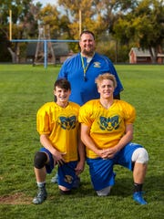 Carter Miller, Parowan football's head coach, poses for a photo with his sons Ñ Hutch and Porter Ñ after practice on Tuesday, September 27, 2017.