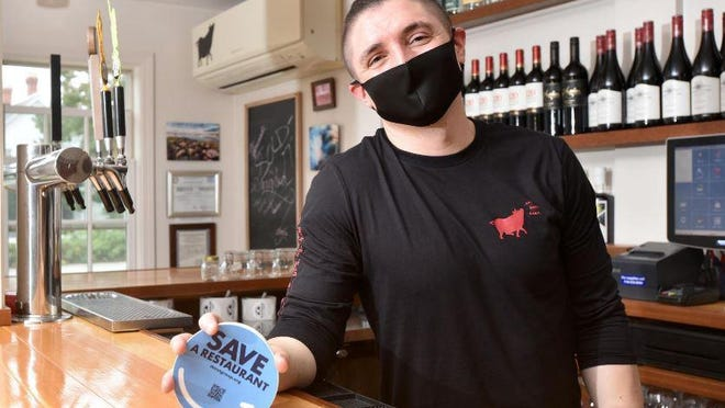 Jeff Mitchell, of the Talkative Pig restaurant in South Chatham, Massachusetts, is working to get a bill passed in the state Legislature that will require insurance companies to pay claims to hospitality businesses that were forced to close because of the pandemic.