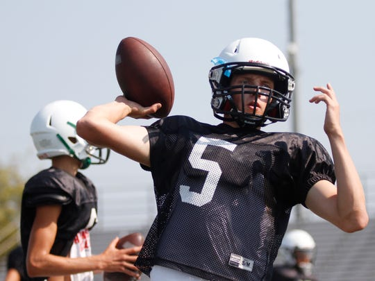 Junior quarterback Freddie Ricketts throws a pass during Thousand Oaks practice.