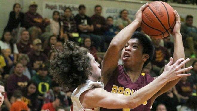Cherokee senior Jason McMillan, right, has signed to play college basketball for Western Carolina University.