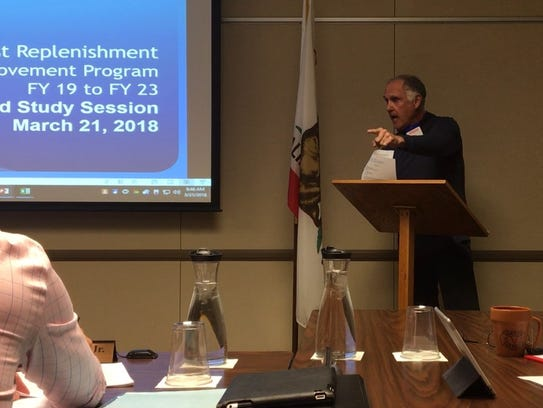 Randy Roberts points at Coachella Valley Water District Board President John Powell, Jr., while raising concerns about potential conflicts of interest during a meeting on Wednesday in Coachella.