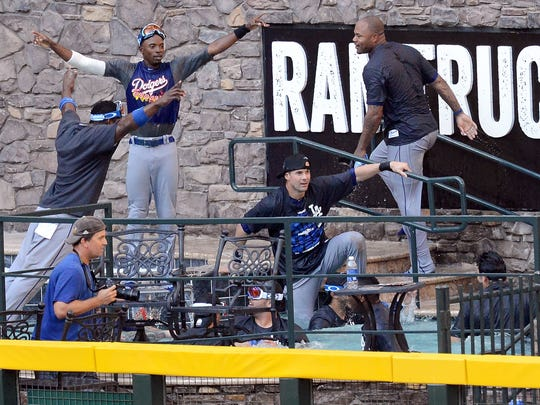 Los Angeles Dodgers players jump in the pool after
