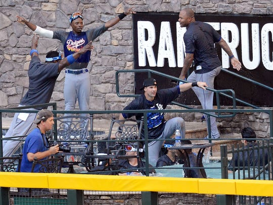 Dodgers players jump in the pool at Chase Field after clinching the NL West title.