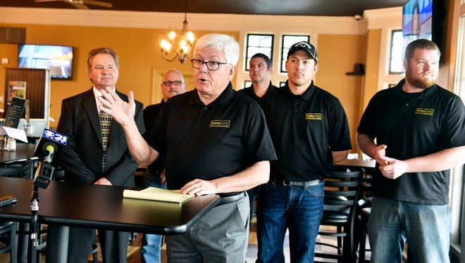 Former York County Commissioner Steve Chronister, front, says that BrewVino LLC will be purchasing Grandview Golf Club. Behind Chronister are, from left, Greg Bower; pro shop manager Wayne Morris; BrewVino general manager Brian Polachek; and BrewVino owners/managers Jordan Chronister and Marc Bower. Steve Chronister said he's not part of the group buying Grandview but will assist with managing and marketing the golf course.