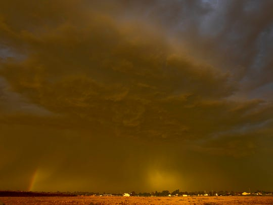 In this Aug. 18, 2011 file photo, a dust storm also known as a haboob in Arabic and around Arizona hovers over Queen Creek, Ariz. Drought is tightening its grip across a wide swath of the American Southwest as farmers, ranchers and water managers throughout the region brace for what's expected to be more warm and dry weather through the spring. The federal drought map released Thursday, March 29, 2018, shows dry conditions intensifying across northern New Mexico and into southwestern Arizona. Every square mile of Nevada and Utah also are affected by at least some level of dryness.