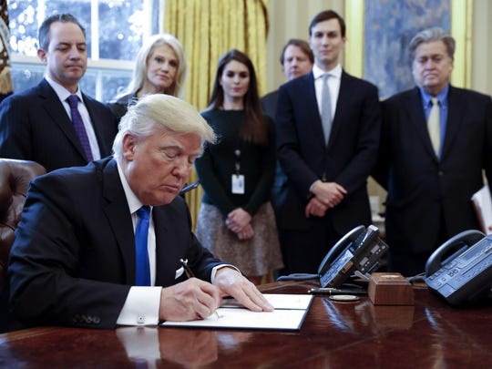 US President Trump signs executive order to allow Dakota,. Keystone pipelines