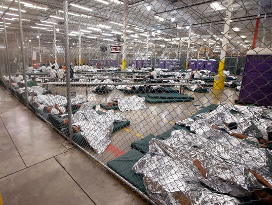 Image result for family separation boys in cages