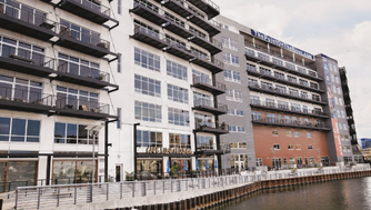 Sales at downtown Milwaukee area condominium buildings, such as Point on the River, continued rebounding in 2016, according to a new report.