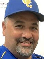John Carroll Catholic softball coach Rico Rosado has