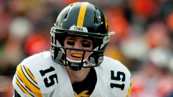 Iowa quarterback Jake Rudock calls signals against Illinois on Nov. 15, 2014, at Memorial Stadium in Champaign, Ill.