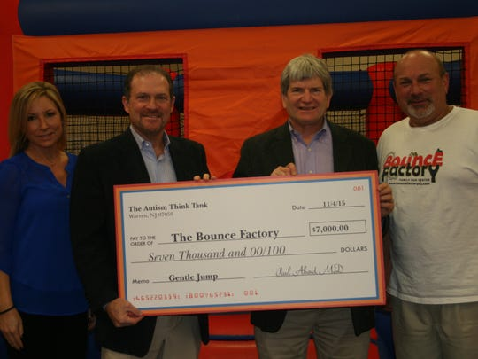 "Sheri Haiken, director of the Autism Think Tank, NJ Dr. Paul Abend, founder of the Autism Think Tank, NJ Warren resident Steve Pillar on behalf of B'nai Brith Food Services and Tony D'Amato, owner of The Bounce Factory celebrate the generous donation by B'nai Brith for ""gentle jump"" sessions at The Bounce Factory."