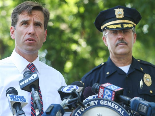 Attorney General Beau Biden (left) and Wilmington police Chief Michael hold a press conference on July 3, 2012. Biden, who died in May, championed measures to safeguard children.