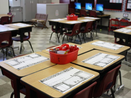 School desks in an empty classroom.