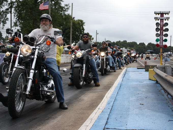 Bikers line up for the annual Bikers Who Care Toy Run.