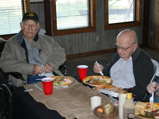 C. Ray Dean and A.J. Dean enjoy their meal at the 82nd