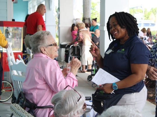 A Grand Oaks employee and resident dance together