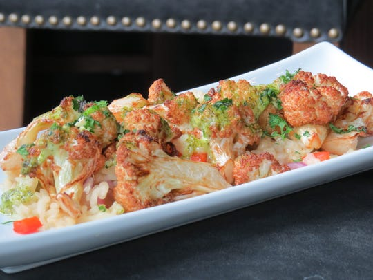 """A lunch-time serving of fried cauliflower with chipotle risotto, Parmesan and """"chef's specialty sauces"""" is seen at Casa Bella Prime Steak and Seafood in downtown Ventura."""