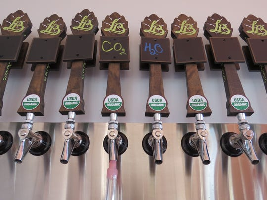 Tap handles are seen at Leashless Brewing Co., which will feature certified-organic Belgian-style ales when it opens to the public on July 8 in downtown Ventura.