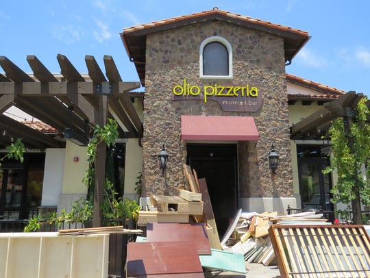 Assorted furnishings are seen outside the former Olio