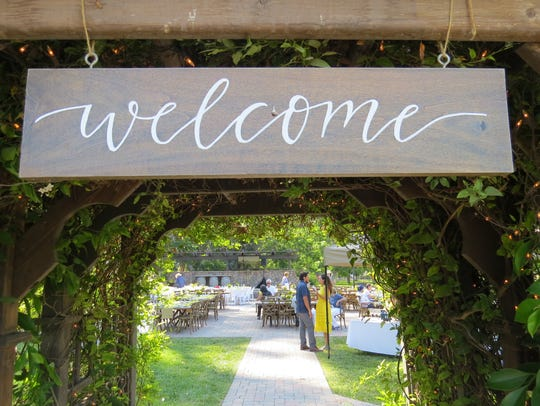 A sign welcomes attendees to the seventh annual From
