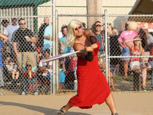 Kelly Conley takes a swing at a previous Delhi Skirt Game. This year's event will be Friday, Aug. 4, at Delhi Park.