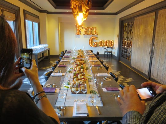 Guests photograph the table before sitting down to a private dinner in the Wellness Kitchen at Four Seasons Hotel Westlake Village.