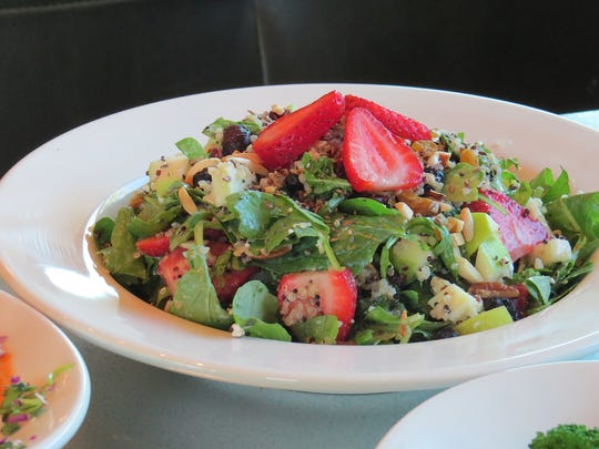 Menu items at Sharky's Woodfired Mexican Grill include the harvest quinoa salad with toasted flax and chia seeds.