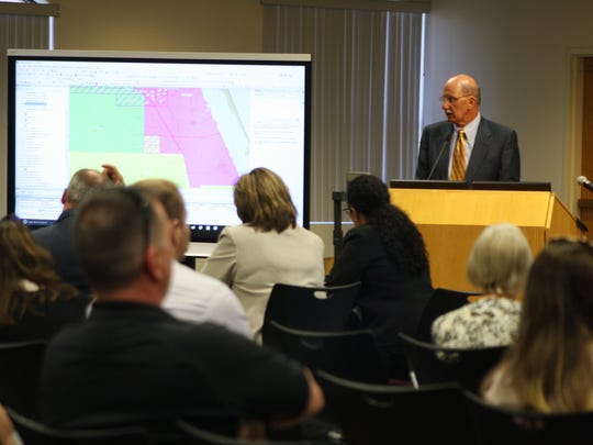 Assistant superintendent of facilities for the Brevard County school district, Dane Theodore presents his recommendation to rezone some schools in the county at a workshop Tuesday. A couple dozen residents from West Melbourne, who are angered by the possibility of moving kids from the A-rated Melbourne High to the C-rated Palm Bay High, came out to the meeting.