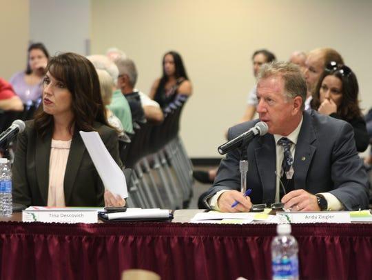 School board members Tina Descovich and Andy Ziegler