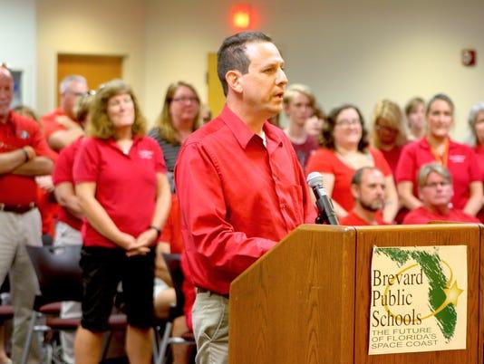 Dan-Bennett-teacher-raises-CarolineGlenn.JPG