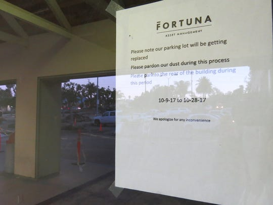Replacement of the parking lot for the Ventura shopping center occupied by Grocery Outlet Bargain Market and other retailers is expected to be completed on Oct. 28, according to a notice taped to the window of a vacant storefront.