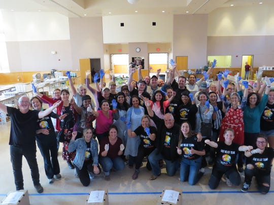 World Central Kitchen volunteers gather for a group photo with chef and founder Jose Andres during his Dec. 18 visit to O'Brien Hall at the San Buenaventura Mission in Ventura. The food-relief effort for Thomas Fire evacuees and first responders in Ventura and Santa Barbara counties was active from Dec. 10-22.